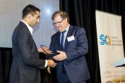 Macquarie Bank representative Merrick D'Souza presenting Peter Hartley with the Macquarie Bank Essay Award (photo courtesy of Artificial Studios)